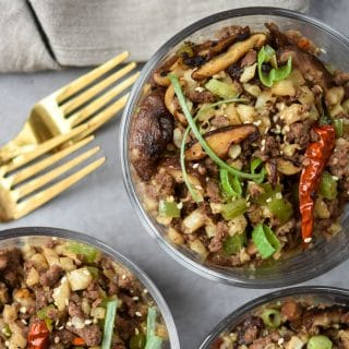 Kung Pao Beef & Cauliflower Rice Bowls with forks hero shot