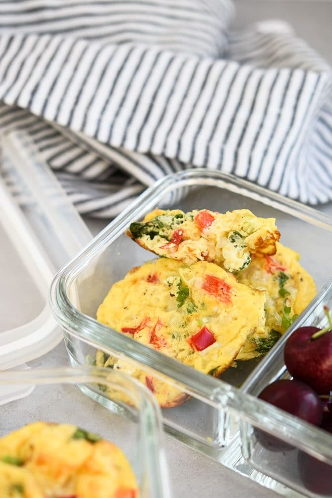 Baked Cottage Cheese Egg Muffins in meal prep container with cherries