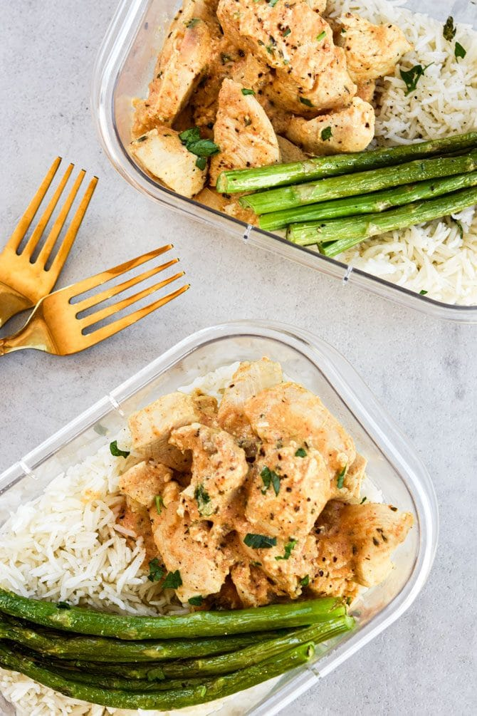 Dijon Thyme Chicken Tenders two meal prep containers with forks