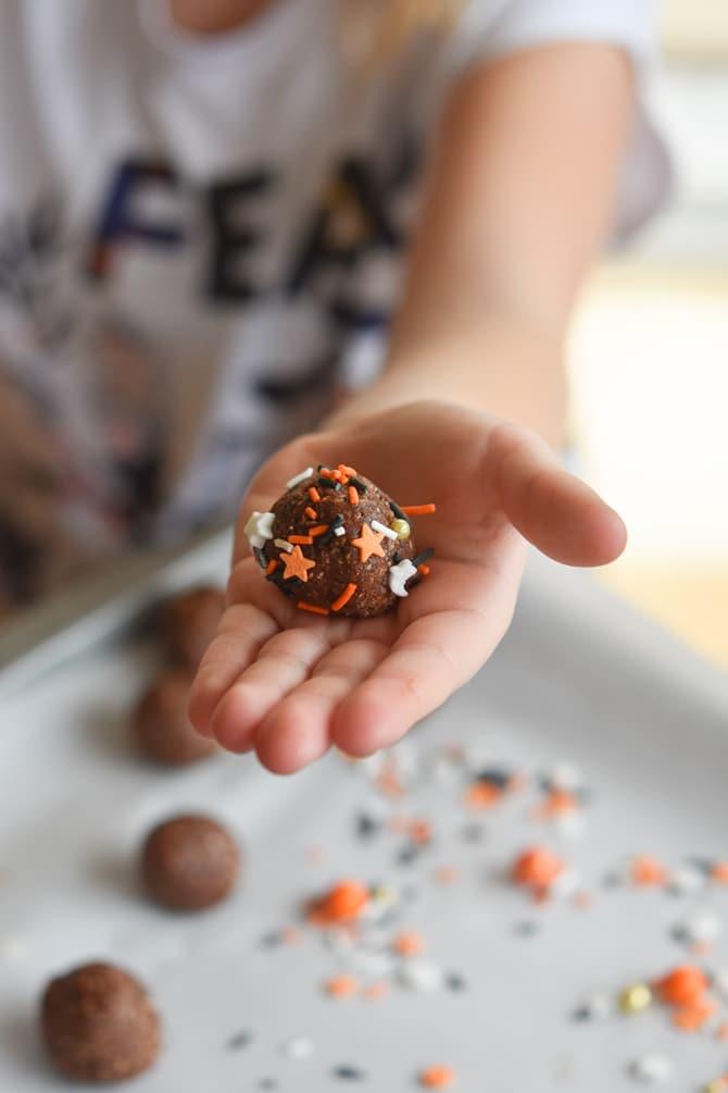 Healthy Halloween Brownie Bites decorated in kid hand