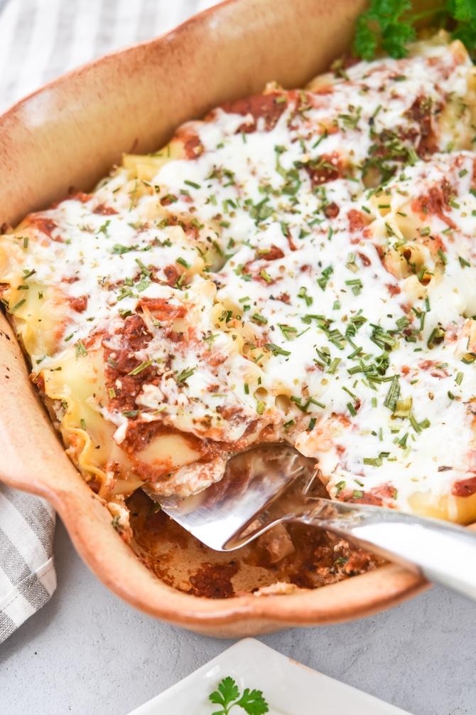 Veggie Loaded Lasagna Roll Ups in baking dish