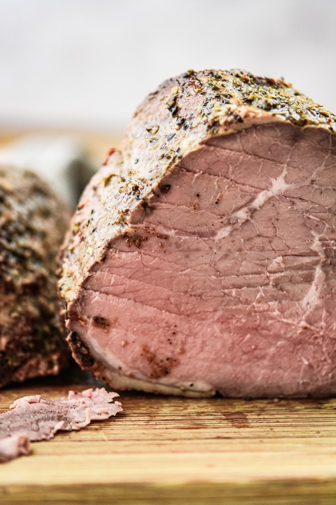 Homemade Roast Beef Deli Style Meat whole with slice taken off