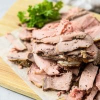 Roast Beef sliced thin on cutting board from above