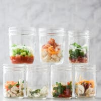 Stacked mason jar omelette jars with ingredients