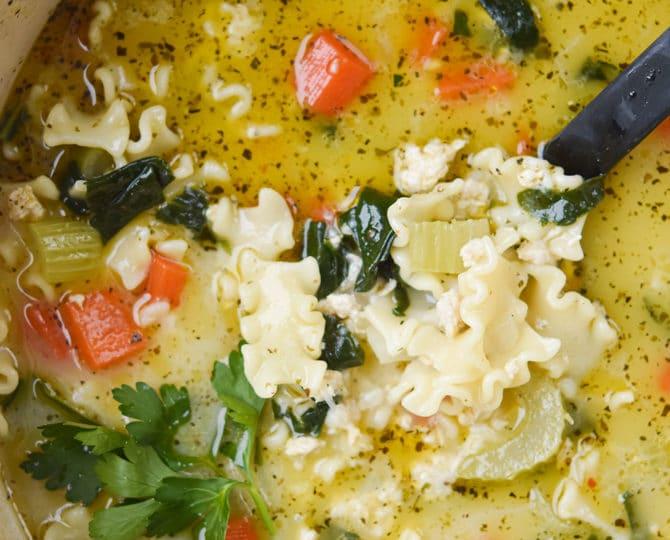 chicken lasagna soup close up in a ladle