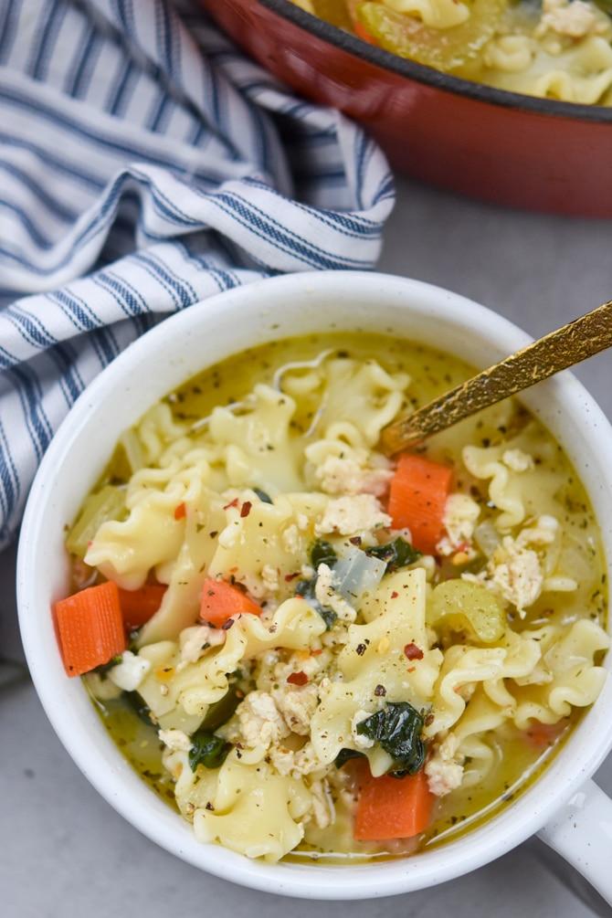 chicken lasagna soup in a bowl flatlay close up