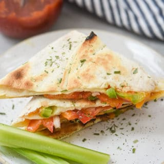Veggie quesadilla plated with celery_hero shot