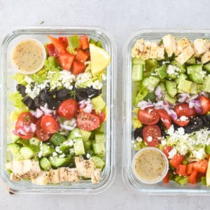 2 greek salad meal preps side by side landscape