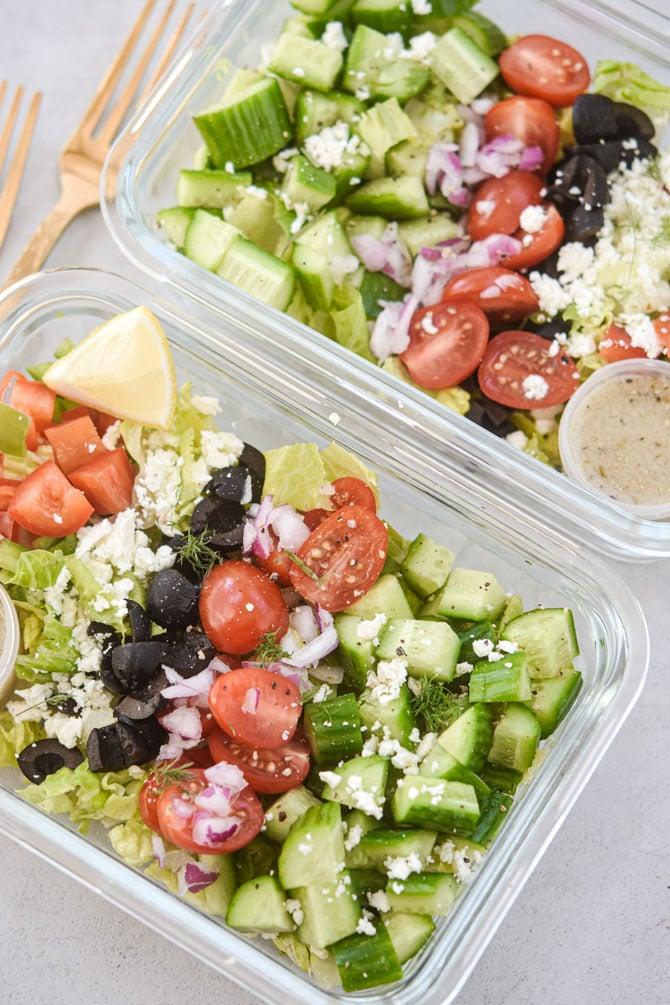 2 greek salad meal preps side by side portrait