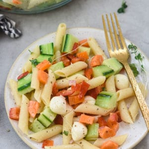 pasta salad plated with gold fork