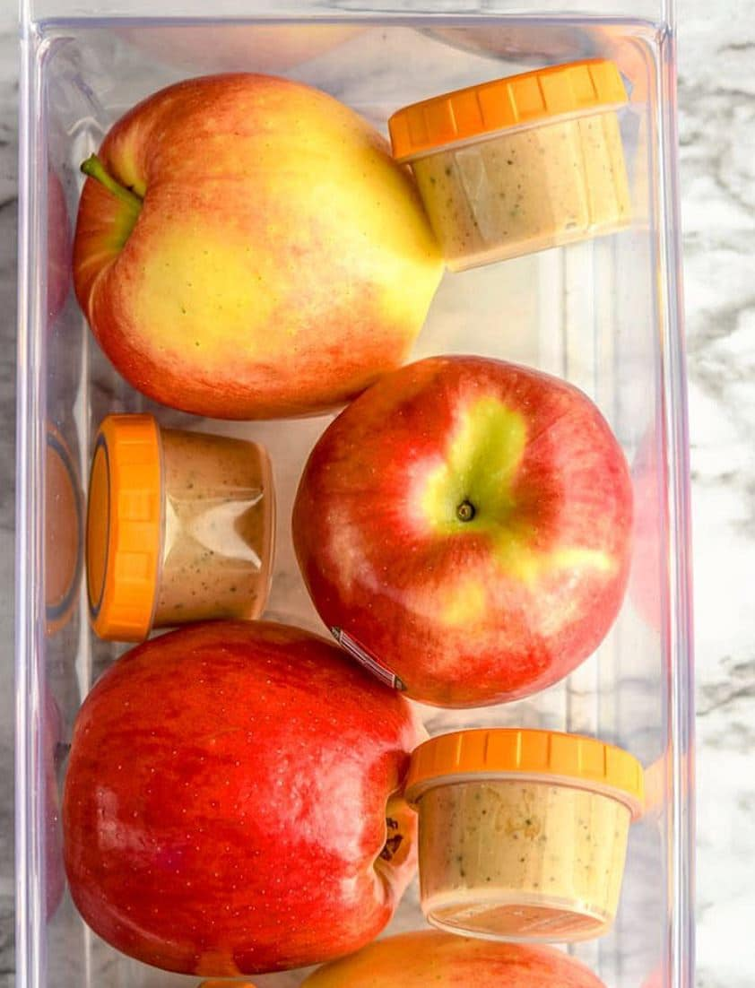 apples and peanut butter in bin