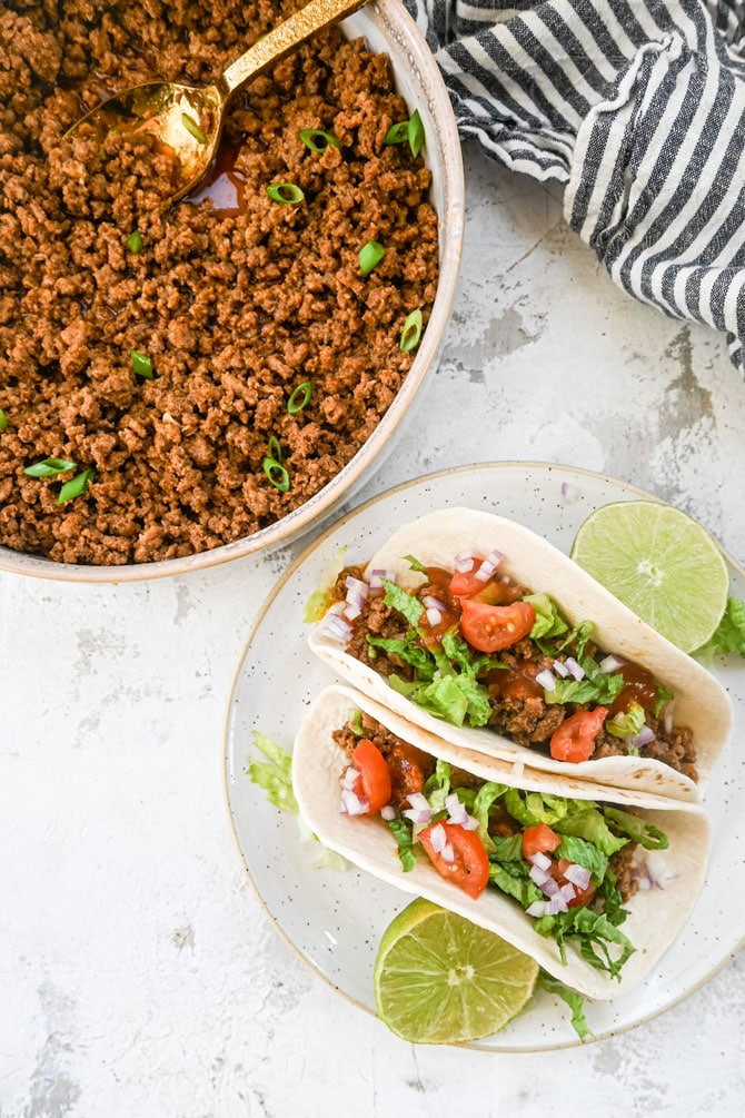 Taco beef tacos with beef in bowl flatlay