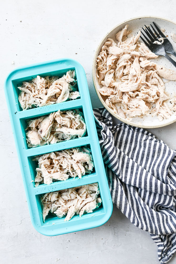 Shredded chicken in souper cube trays an in a bowl